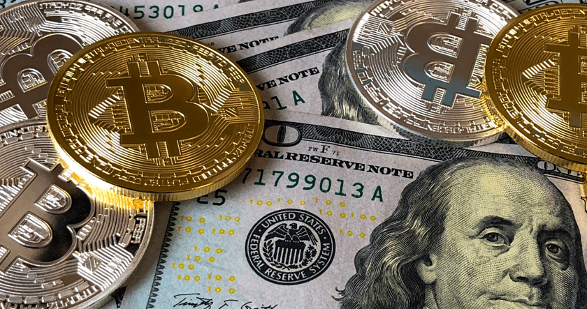 Dollar bills and bitcoins