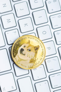Golden dogecoin coin. Cryptocurrency dogecoin. Doge cryptocurrency and computer keyboard.