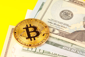 golden bitcoin coin and us dollars image